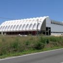 Архитектурное решение при оформлении фасада производственного строения с помощью ПTFE ткани