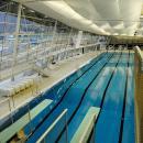Оформление потолка бассейна тканью с комплексным использованием светильников